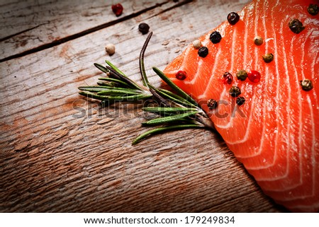 Salmon with lemon and pepper  - stock photo