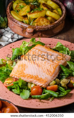 Salmon with roasted potatoes and mediterranean vegetables and salad