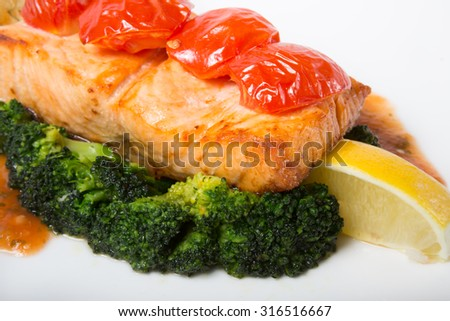 Salmon with vegetables garnish