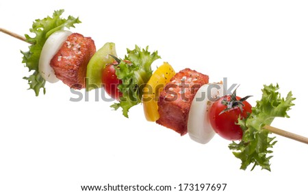 salmon with vegetables on a skewer isolated on white background