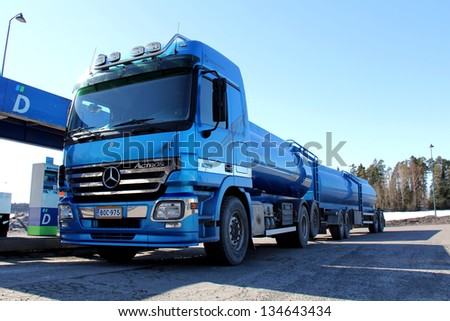 SALO, FINLAND - APR 6: Mercedes Benz Actros truck refueled at a petrol station in Salo, Finland on Apr 6, 2013. MB has chosen SCR technology to meet Euro 4 and 5 exhaust incentive emission standards. - stock photo