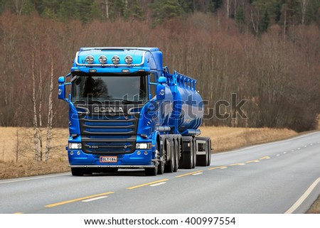 SALO, FINLAND - APRIL 1, 2016: New, blue Scania R580 tank truck for bulk transport customized with lighting accessories moves along road in South of Finland.  - stock photo
