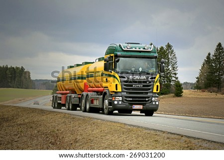 SALO, FINLAND - APRIL 3, 2015: Scania R500 tank truck on the road on cloudy weather. Study shows Scania supplies the most efficient alternative fuel technology.  - stock photo
