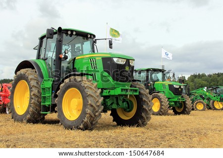 SALO, FINLAND - AUGUST 10: John Deere agricultural tractors 6170M and 6190R on display at the annual Puontin Peltopaivat Agricultural Harvesting and Ploughing Show on August 10, 2013 in Salo, Finland. - stock photo