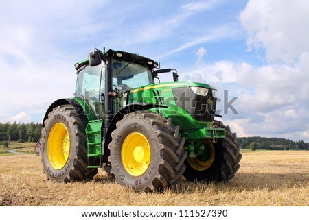SALO, FINLAND - AUGUST 18: Modern John Deere tractor on display at the annual soil preparation and harvesting event Puontin peltopaivat at Puonti field in Salo, Finland August 18, 2012. - stock photo