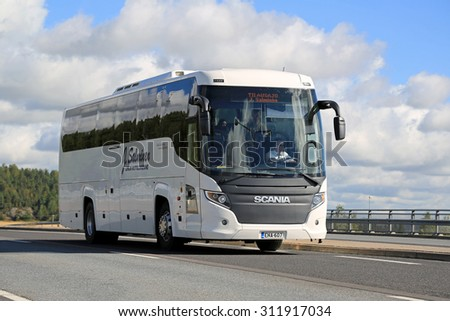SALO, FINLAND - AUGUST 29, 2015: White Scania Touring coach bus on the road in Salo. The Scania Touring is a tourist coach with Chinese-build Higer bodywork.   - stock photo