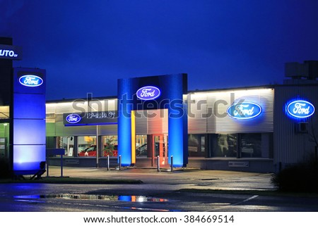 SALO, FINLAND - DECEMBER 13, 2015: Street view of Ford dealer PP Auto store by night in Salo, Finland. Ford's European New Vehicle Sales Rise 11% in 2015. - stock photo