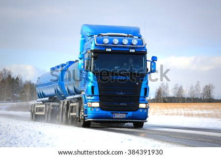 SALO, FINLAND - FEBRUARY 13, 2016: Blue Scania R500 tank truck on the road in winter weather. In 2015, Scania is Finnish the market leader in heavy trucks. - stock photo