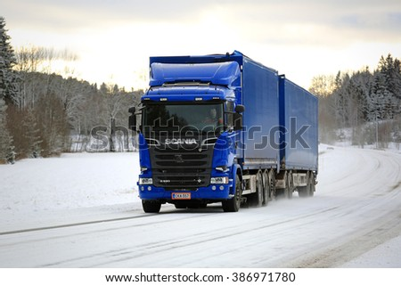 SALO, FINLAND - FEBRUARY 5, 2016: New, blue Scania R520 cargo truck on the road on a winter afternoon in South of Finland. In 2015, Scania is Finnish the market leader in heavy trucks. - stock photo