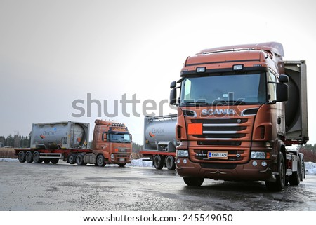 SALO, FINLAND - JANUARY 17, 2015: Scania R500 and Volvo FH tank trucks haul flammable goods. The ADR label 50-1495 stands for sodium chlorate. - stock photo