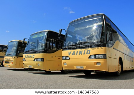SALO, FINLAND - JULY 14, 13: Vainion Liikenne buses parked in Salo, Finland on July 14, 13. Matti Vainio, CEO of Vainion Liikenne, continues the Chairman of Finnish Bus and Coach Association in 2013. - stock photo