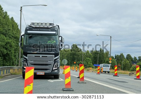 SALO, FINLAND - JULY 31, 2015: Volvo FH truck driving through road works in Salo, Finland. Road works slow down traffic particularly in South of Finland during the summer months of 2015.