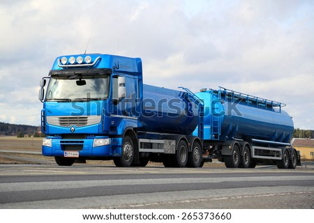 SALO, FINLAND - MARCH 22, 2015: Blue Renault Premium 460 tank truck on the road. Renault Trucks announces laboratory vehicle's fuel consumption lowered by 22 % after intense testing. - stock photo
