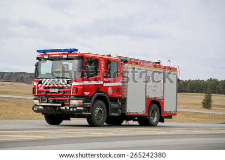 SALO, FINLAND - MARCH 22, 2015: Scania Fire truck on highway 52. A traditional Scania water/rescue tender is typically built in a 4x2 or 4x4 configuration, with a 6 to 8 person CrewCab. - stock photo