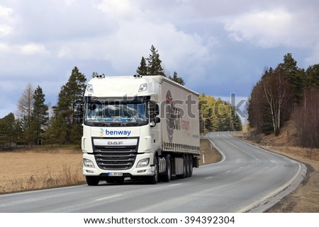 SALO, FINLAND - MARCH 20, 2016: White DAF XF Semi truck on the road in South of Finland. In 2016, DAF celebrates 50 years of production in Belgium. - stock photo