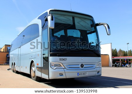 SALO, FINLAND - MAY 4: MB bus on a bus stop in Salo, Finland on May 4, 13. Since Mar 1, the new EU Bus and Coach regulation grants passenger rights similar to those for air, train and boat transport. - stock photo