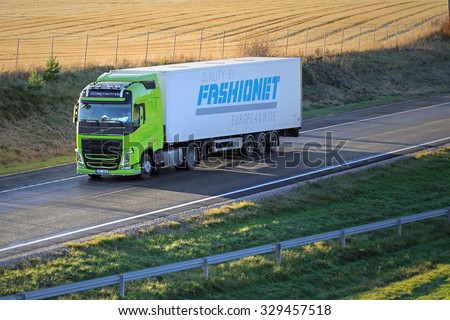SALO, FINLAND - OCTOBER 18, 2015: Lime green Volvo FH 500 semi truck on motorway. Volvo Trucks launches positioning service for time-critical transports. - stock photo