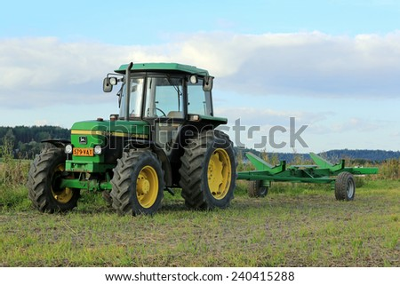 SALO, FINLAND - SEPTEMBER 6, 2014: John Deere 2850 utility tractor and agricultural trailer. The model 2850 was manufactured between 1986-1994 in Germany and Argentina.  - stock photo