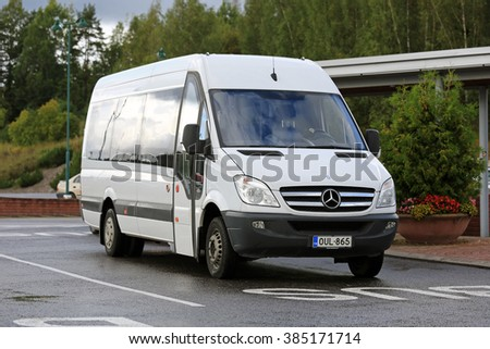 SALO, FINLAND - SEPTEMBER 5, 2015: White Mercedes-Benz Sprinter minibus stops at bus parking in South of Finland. The MB Sprinter has a seating capacity from 13 to 19 passengers. - stock photo