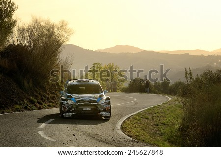 SALOU, SAPIN - OCT 25: American driver Ken Block and his codriver Alex Gelsomino in a Ford Fiesta RS WRC race in the 50th Rally RACC Rally of Spain, on Oct 25, 2014 in Salou, Spain. - stock photo