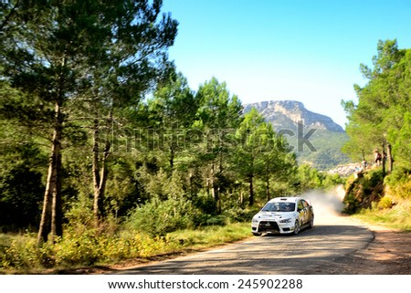 SALOU, SAPIN - OCT 25: Andorran driver Joan Carchat and his codriver Claudi Ribeiro in a Mitsubishi Lancer Evo X race in the 50th Rally RACC Rally of Spain, on Oct 25, 2014 in Salou, Spain. - stock photo
