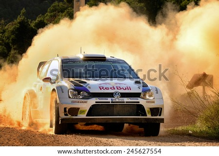 SALOU, SAPIN - OCT 25: Finnish driver Jari-Matti Latvala and his codriver Mikka Anttila in a Volkswagen Polo R WRC race in the 50th Rally RACC Rally of Spain, on Oct 25, 2014 in Salou, Spain. - stock photo
