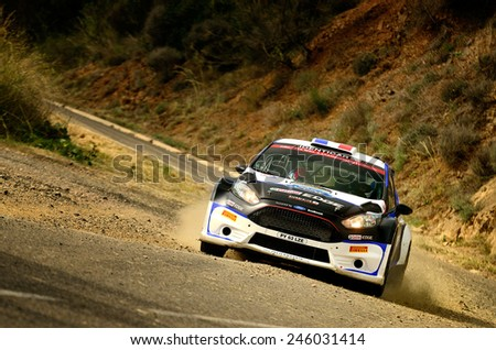 SALOU, SAPIN - OCT 25: French driver Julien Maurin and his codriver Nicolas Klinger in a Ford Fiesta R5 race in the 50th Rally RACC Rally of Spain, on Oct 25, 2014 in Salou, Spain. - stock photo