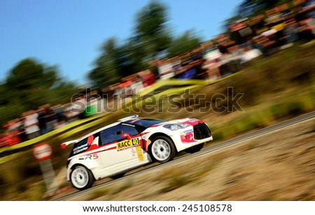 SALOU, SAPIN - OCT 25: French driver Sebastien Chardonnet and his codriver Thibault De La Haye in a Citroen DS3 R5 race in the 50th Rally RACC Rally of Spain, on Oct 25, 2014 in Salou, Spain. - stock photo