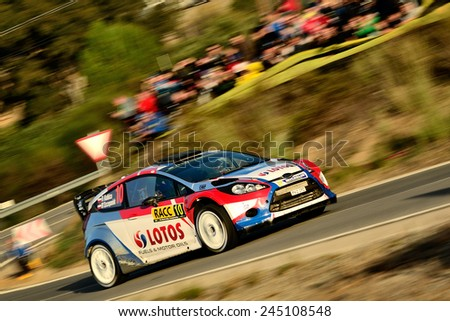 SALOU, SAPIN - OCT 25: Pole driver Robert Kubica and his codriver Maciek Szczepaniak in a Ford Fiesta RS WRC race in the 50th Rally RACC Rally of Spain, on Oct 25, 2014 in Salou, Spain.