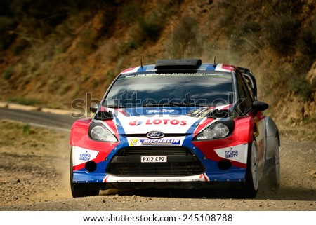 SALOU, SAPIN - OCT 25: Pole driver Robert Kubica and his codriver Maciek Szczepaniak in a Ford Fiesta RS WRC race in the 50th Rally RACC Rally of Spain, on Oct 25, 2014 in Salou, Spain. - stock photo