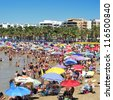 SALOU, SPAIN - AUGUST 10: Vacationers in Llevant Beach on August 10, 2012 in Salou, Spain. Salou is a major destination for sun and beach for European tourism with more than 50,000 accommodations - stock photo