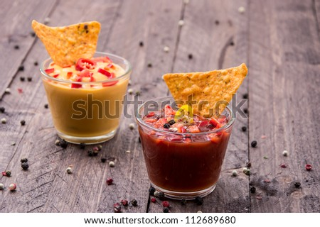 Salsa- and Cheese Sauce in Glasses - stock photo