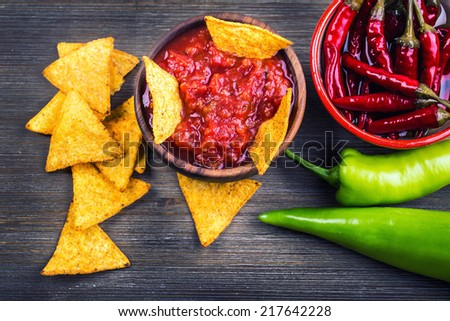 Salsa with tortilla chips and chilli peppers.Concept  - stock photo