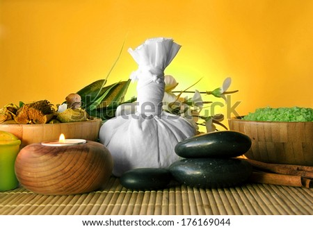 salt and essential round stones for massages and spas - stock photo