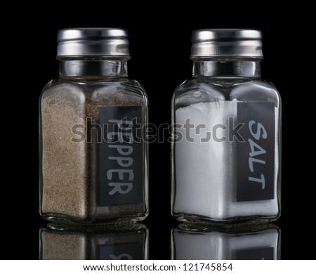 Salt and pepper in a salt shaker - stock photo