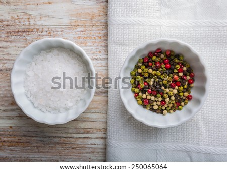 Salt and pepper in white pots - stock photo