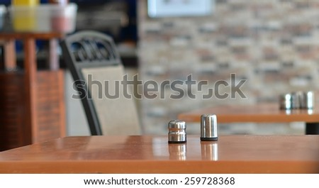 Salt and pepper on an empty table