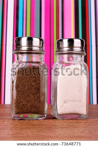 Salt and pepper shaker on color lines background