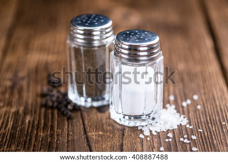 Salt and Pepper Shaker on wooden background (close-up shot; selective focus) - stock photo