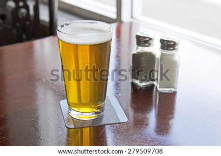 Salt and pepper shakers on a table at a restaurant, - stock photo