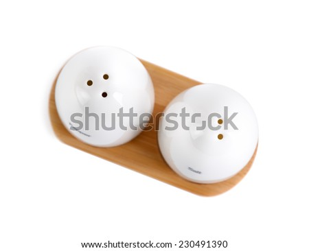 Salt and pepper. Shallow depth of field. Clipping path. - stock photo
