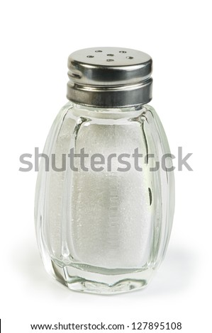 Salt and saltshaker on white background . - stock photo