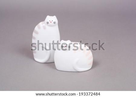 salt-cellar and pepper-box cats closeup - stock photo
