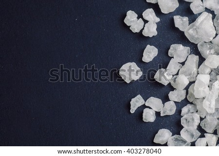 salt closeup on a dark background - stock photo