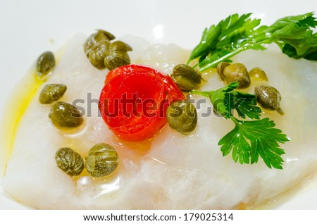 Salt cod capers and tomato - stock photo
