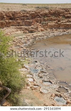 Salt evaporation ponds, Socotra island, Yemen - stock photo