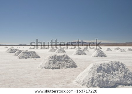 Salt extraction at Salar Uyuni, Bolivia. - stock photo