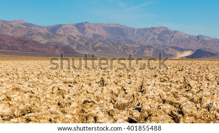 Salt has created complex structures. A rough texture from the large salt crystal formations. The floor of Death Valley is covered by a huge salt pan. Devil's Golf Course, Death Valley National Park - stock photo