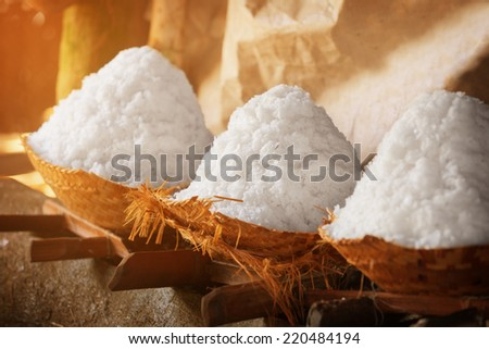 Salt in baskets. Ancient traditional salt production on the Bali island, Indonesia. - stock photo
