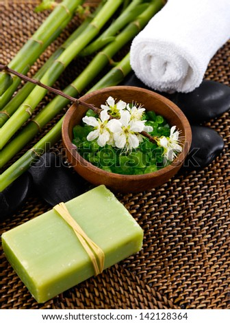 salt in bowl with grove, soap ,towel, flower in spa setting